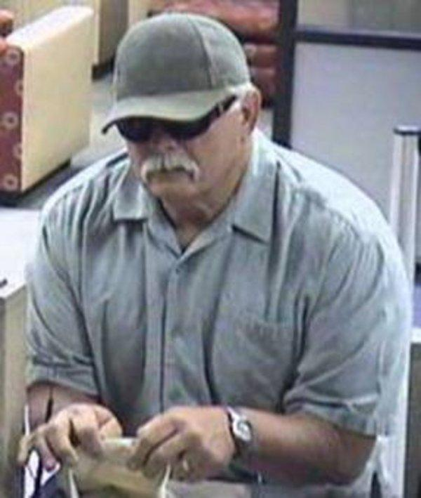 Phil Holder's father, former Police Sergeant Frank Holder, shown here robbing a bank