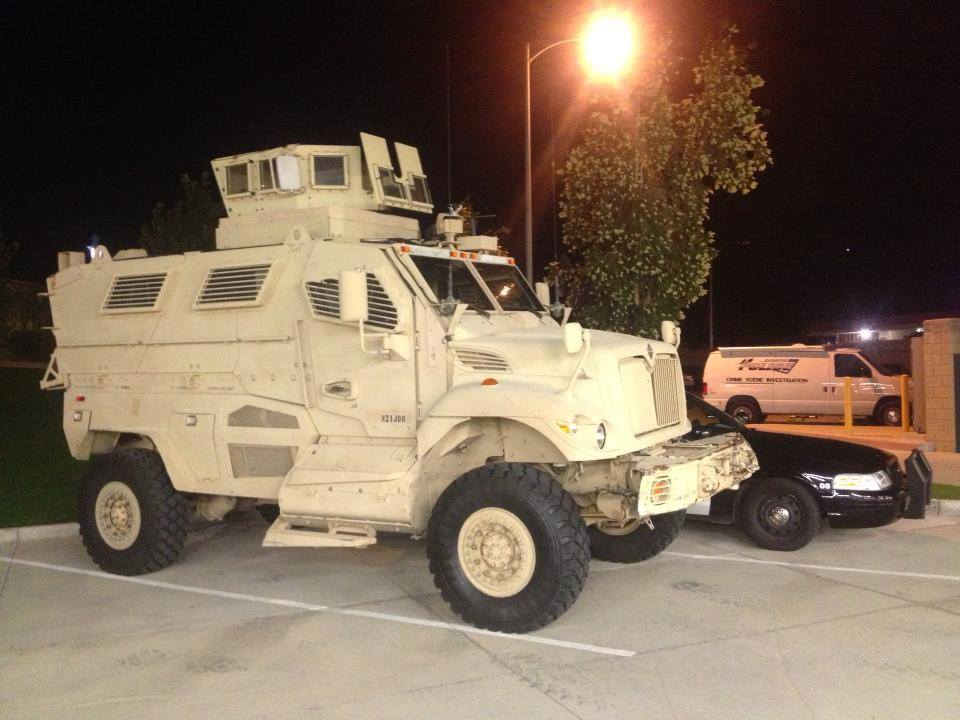 Banning PD's 19 ton armored combat vehicle with 50 cal machine gun turret, seen here parked in Police parking lot. Compare its size to a Crown Victoria sitting next to it