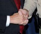 Secret masonic handshake seals the dirty backdoor deal.